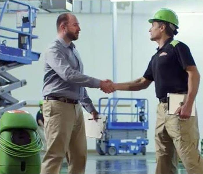 Servpro employee shaking hands with customer