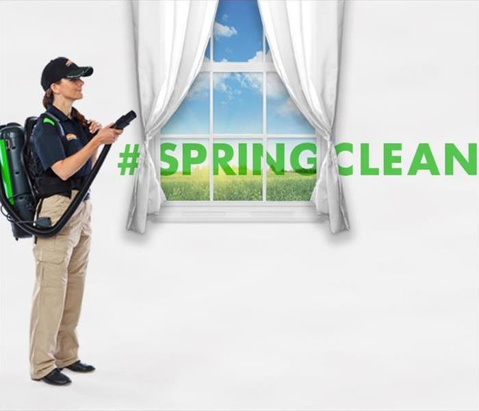 "SERVPRO employee cleaning drapes ""#springcleaning"""